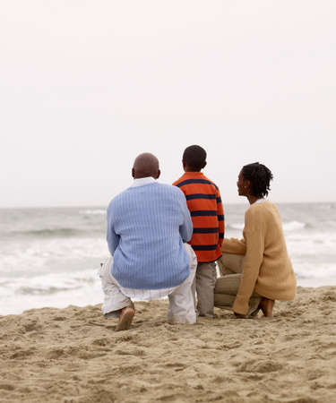 dwelling mound: African family looking at ocean