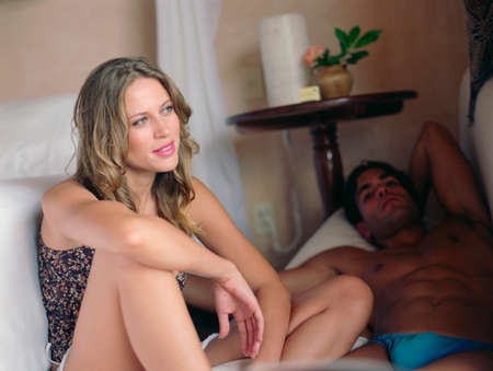 jamaican ethnicity: Couple relaxing next to bed LANG_EVOIMAGES