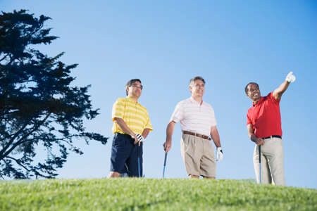fulfilling: Multi-ethnic men on golf course LANG_EVOIMAGES