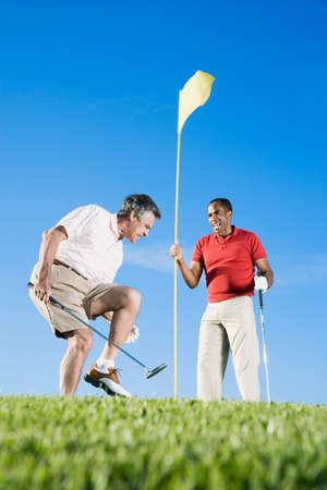 prevailing: Multi-ethnic men playing golf