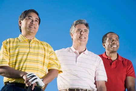 prevailing: Multi-ethnic men under blue sky LANG_EVOIMAGES