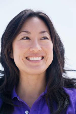 gratifying: Asian woman looking sideways