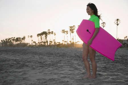 nite: Asian woman holding boogie board
