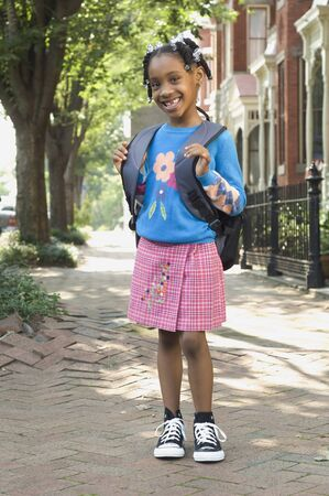 eagerness: African girl wearing backpack