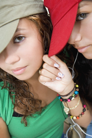 teenaged girls: Hispanic teenaged girls wearing hats