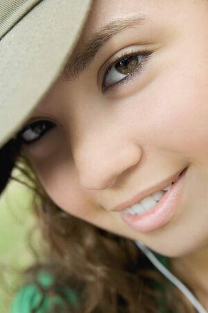 teenaged girl: Close up of Hispanic teenaged girl smiling