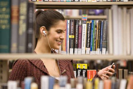 mp3 player: Hispanic woman listening to mp3 player