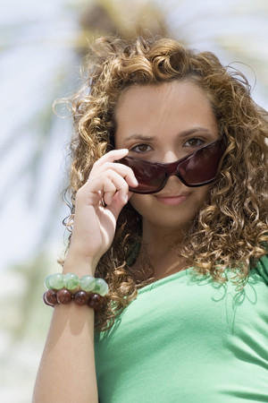 teenaged girl: Hispanic teenaged girl wearing sunglasses