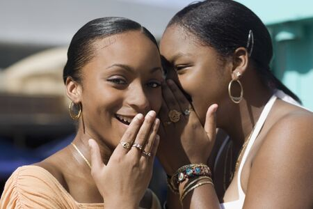 African teenaged girls telling secret Stock Photo