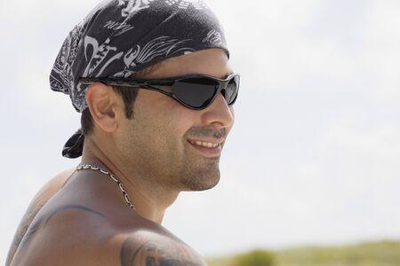 Hispanic man wearing sunglasses