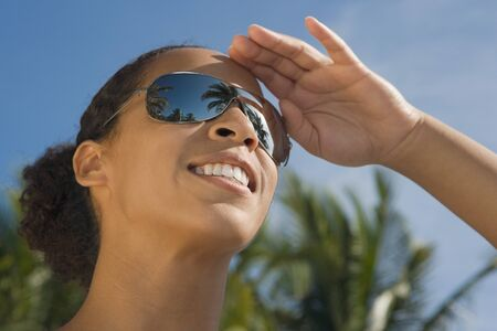 front raise: African woman wearing mirrored sunglasses