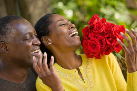 telecommuter: African man surprising wife with flowers