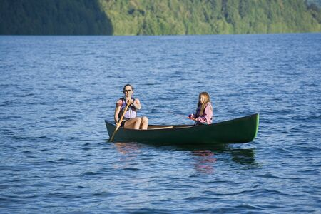 age 40 45 years: Asian mother and daughter rowing in canoe LANG_EVOIMAGES