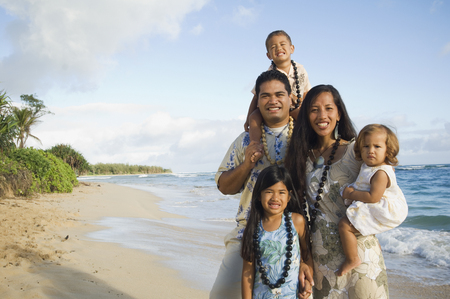 Pacific Islander family at beach Stock Photo