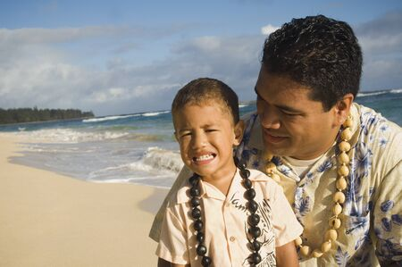 pacific islander ethnicity: Pacific Islander father and son at beach LANG_EVOIMAGES