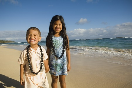 islander: Pacific Islander sister and brother at beach