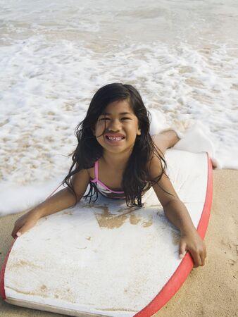 islander: Pacific Islander girl laying on boogie board