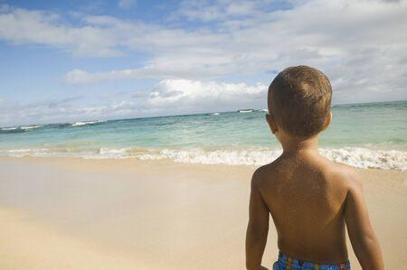Pacific Islander boy looking at ocean