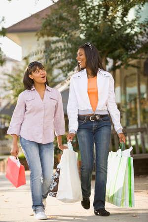 teenaged girls: African teenaged girls carrying shopping bags