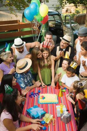 poppa: Hispanic girl celebrating birthday with family