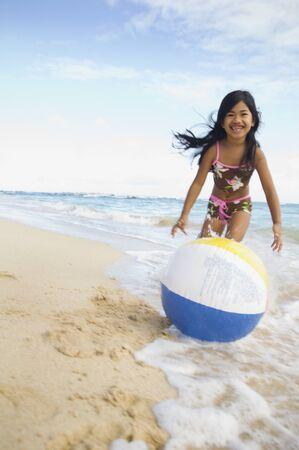pacific islander: Pacific Islander girl playing with beach ball