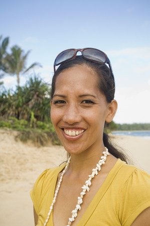 fathering: Pacific Islander woman at beach