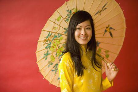 Asian woman holding parasol