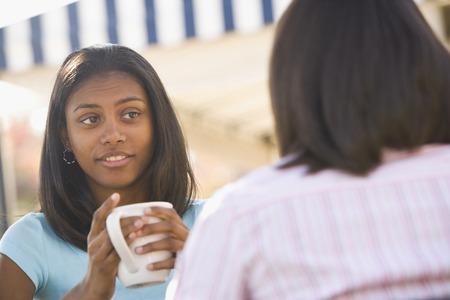 teenaged girl: African teenaged girl talking to friend