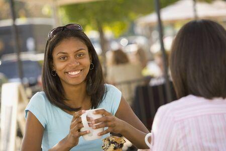 teenaged girl: African teenaged girl holding coffee mug