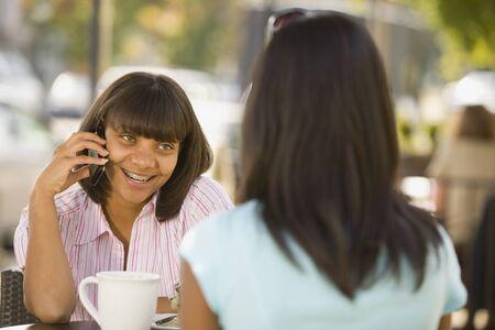 blabbing: African teenaged girl talking on cell phone
