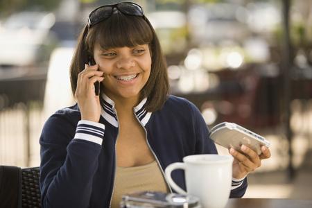 teenaged girl: African teenaged girl talking on cell phone