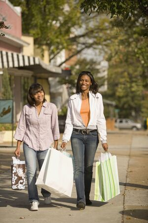 teenaged girls: African teenaged girls carrying shopping bags