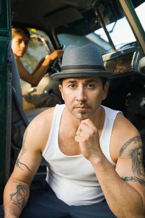 Hispanic man with tattoos Stock Photo