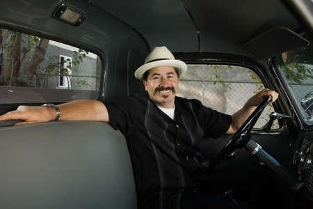 parody: Hispanic man sitting in truck