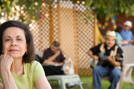 adventuresome: Senior Hispanic woman at outdoor party