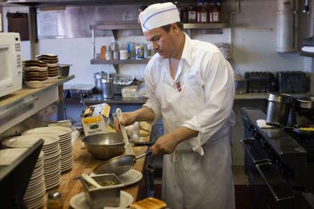 talker: Hispanic male cook in preparing food