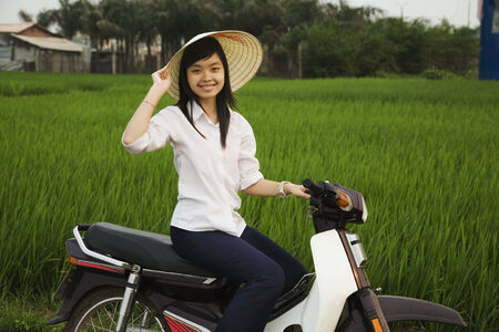 vietnamese ethnicity: Asian woman sitting on motor scooter