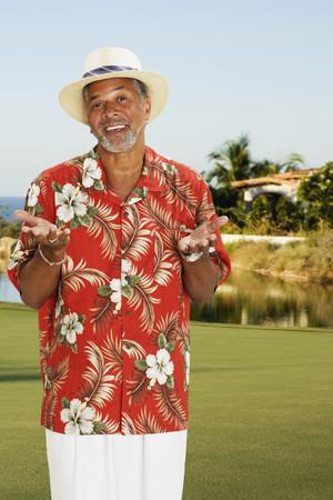 vietnamese ethnicity: African man wearing Hawaiian shirt LANG_EVOIMAGES