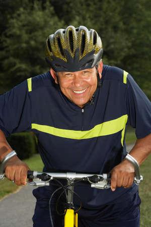 dwelling mound: Hispanic man riding bicycle LANG_EVOIMAGES