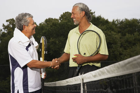 native american baby: Multi-ethnic men shaking hands on tennis court
