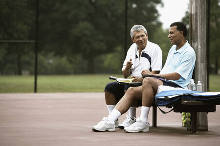 native american baby: Multi-ethnic men talking on tennis court