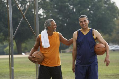 attired: African men holding basketballs