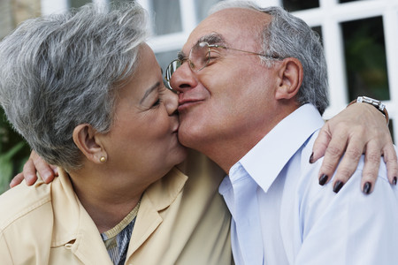 old furniture: Senior Hispanic couple kissing