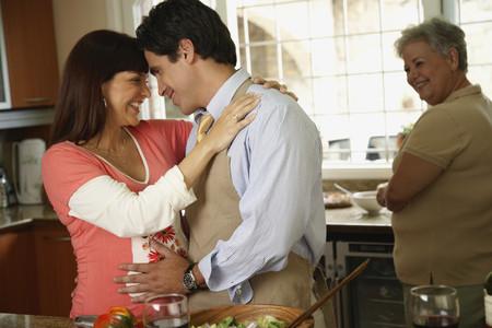 milepost: Pregnant Hispanic couple hugging
