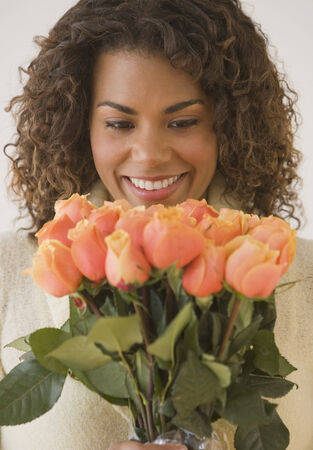 African woman holding bouquet of flowers