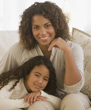 spectating: African girl leaning on mother's lap