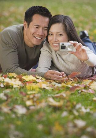 arousing: Asian couple taking own photograph