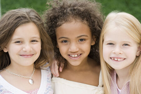 two people fertility: Close up of multi-ethnic girls smiling