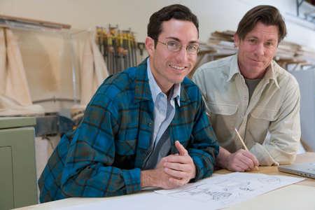 confiding: Multi-ethnic men in wood shop