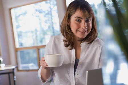 daydreamer: Hispanic woman holding coffee mug